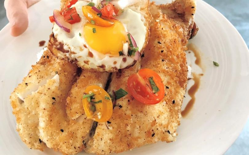 fired fish with fried eggs