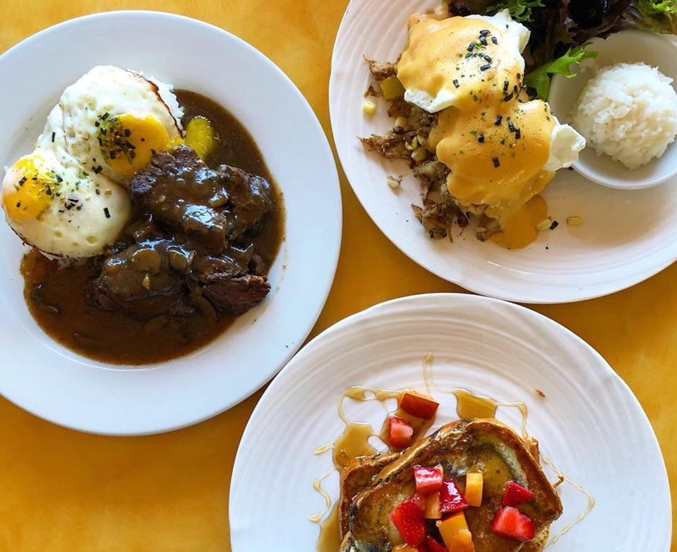 two egg dishes, and a french toast plate