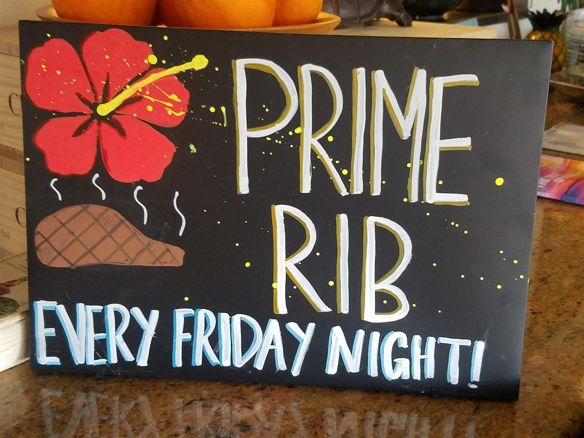 "sign that reads, ""prime rib every Friday night"""
