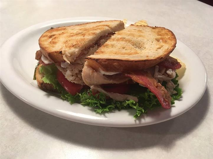 Toeasted sandwich with turkey, bacon, lettuce,  and tomato