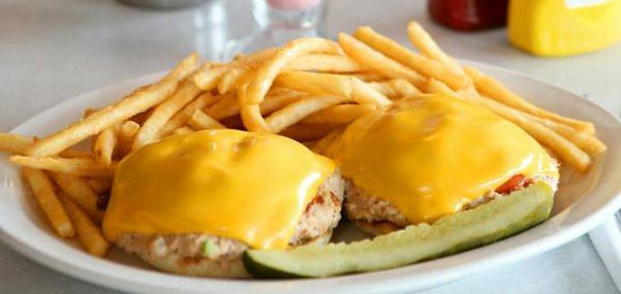 Tuna salad, tomatoes, American cheese, served open face on an English muffin with a side of French fries