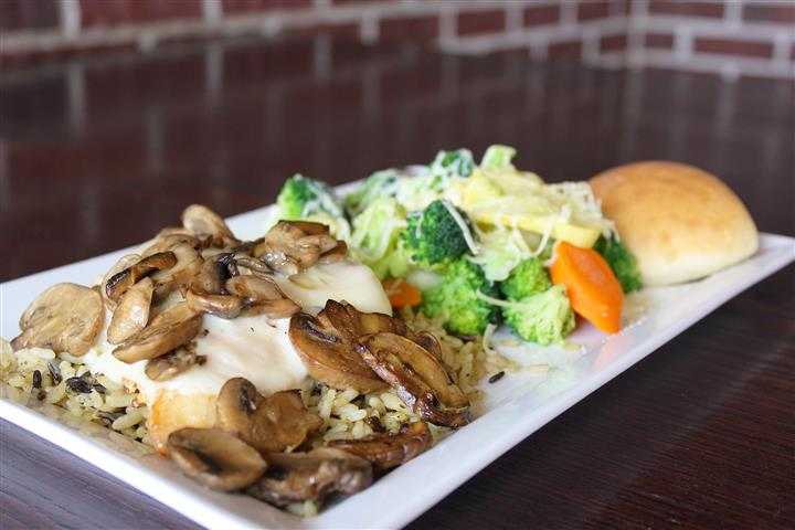 Chicken breast with sautéed mushrooms & provolone cheese