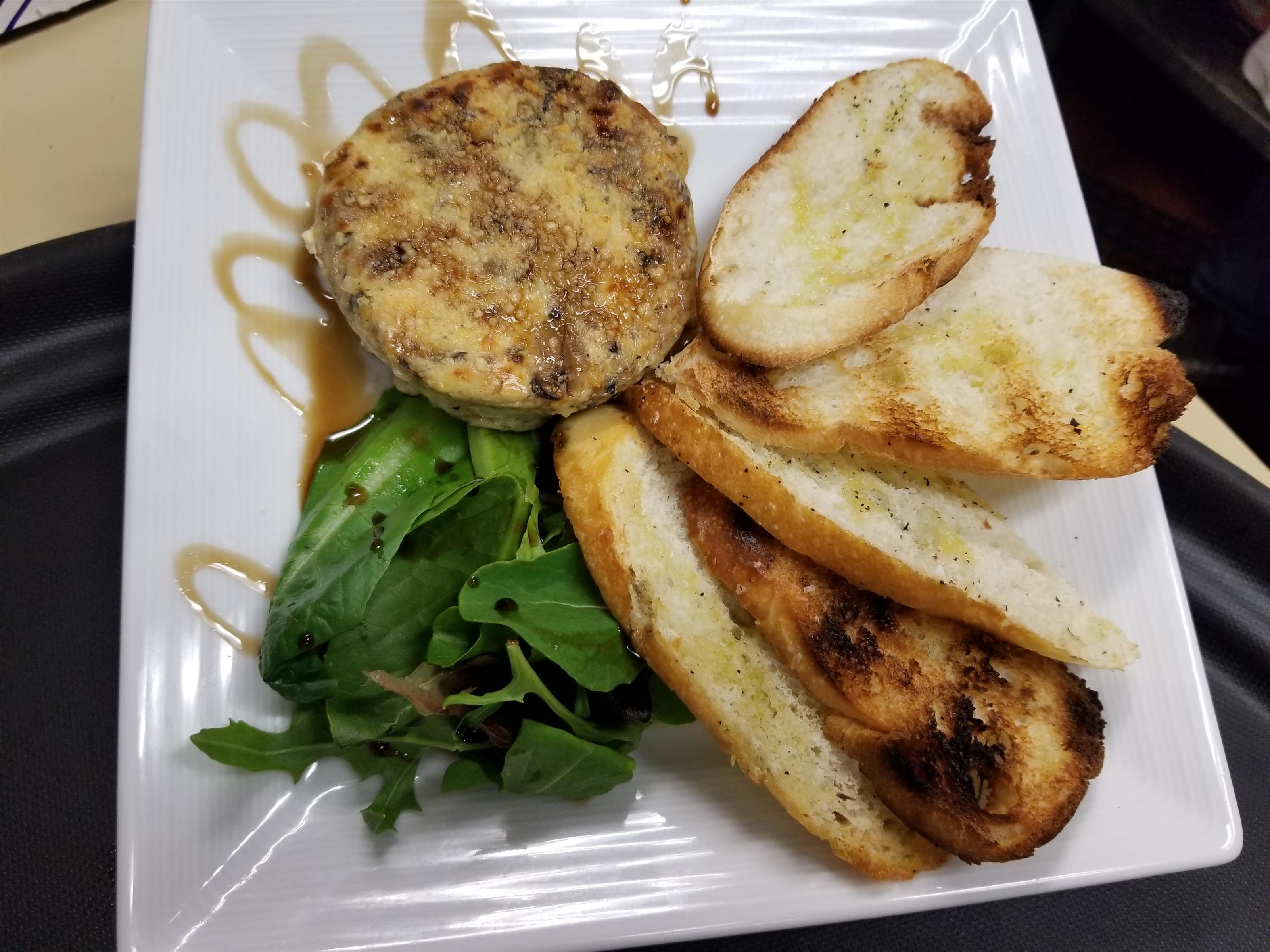 Grilled eggplant with crustini and arugula