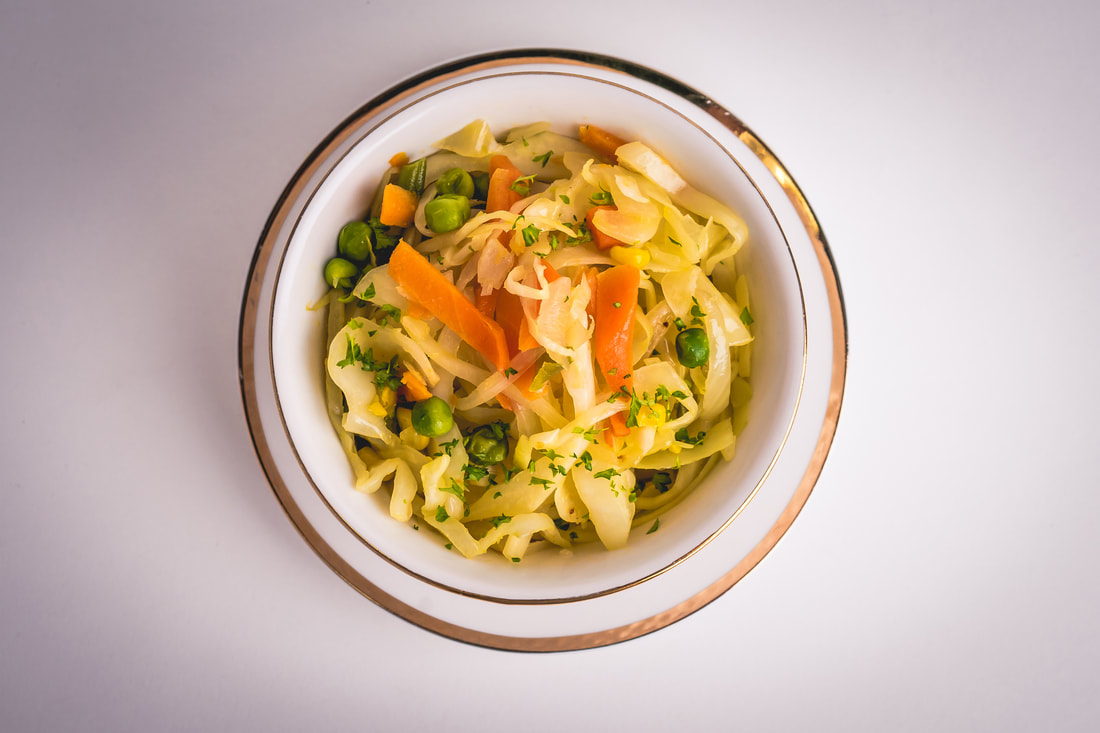 Cabbage salad with carrots and peas