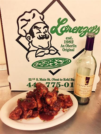 pizza box with wings and wine