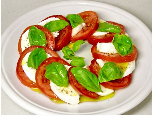 A luscious Caprese Salad with mozzarella, fresh tomatoes and basil.
