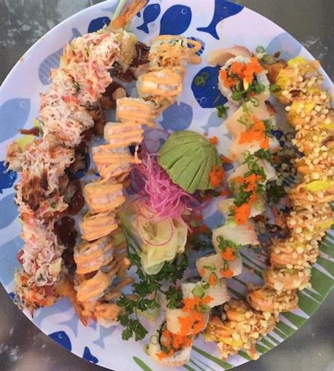 a variety of different sushi rolls on one plate