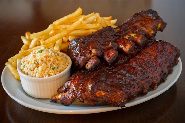 Two slabs of ribs with coleslaw & french fries