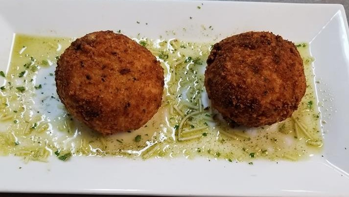 two riceballs on a white plate