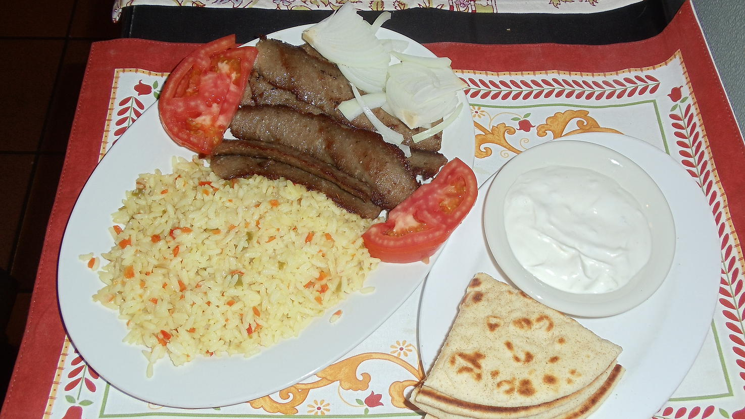 Gyro plate served with pita bread