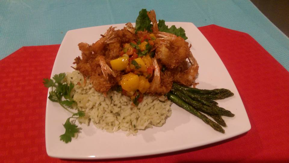 Coconut shrimp over rice ands asparagus