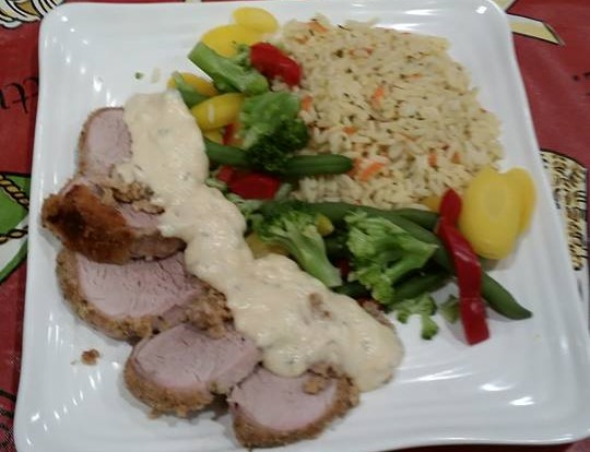 Breaded pork loin with veggies and rice