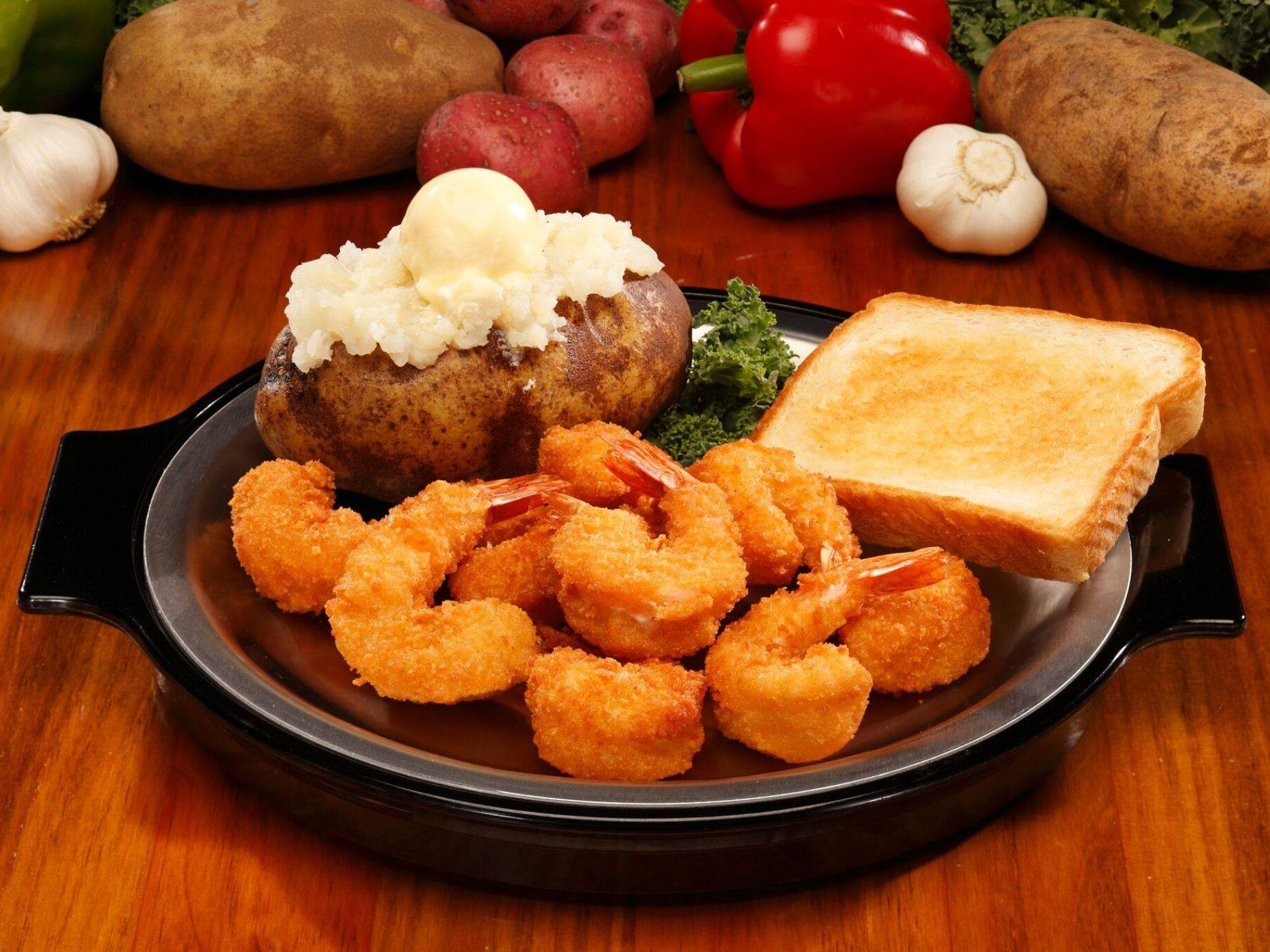 Breaded shrimp with baked potato and Texas toast