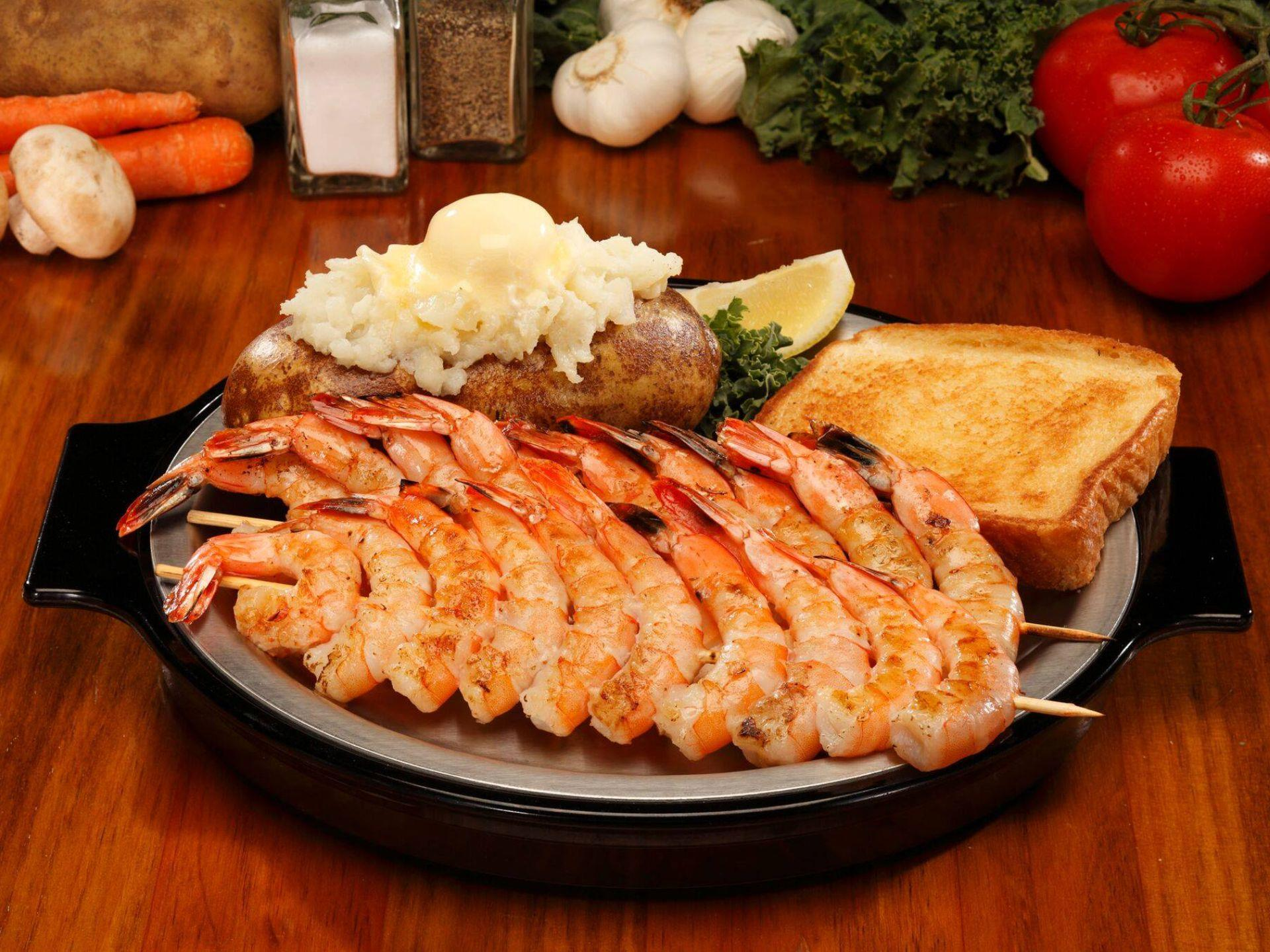 Shrimp skewers with baked potato and Texas toast