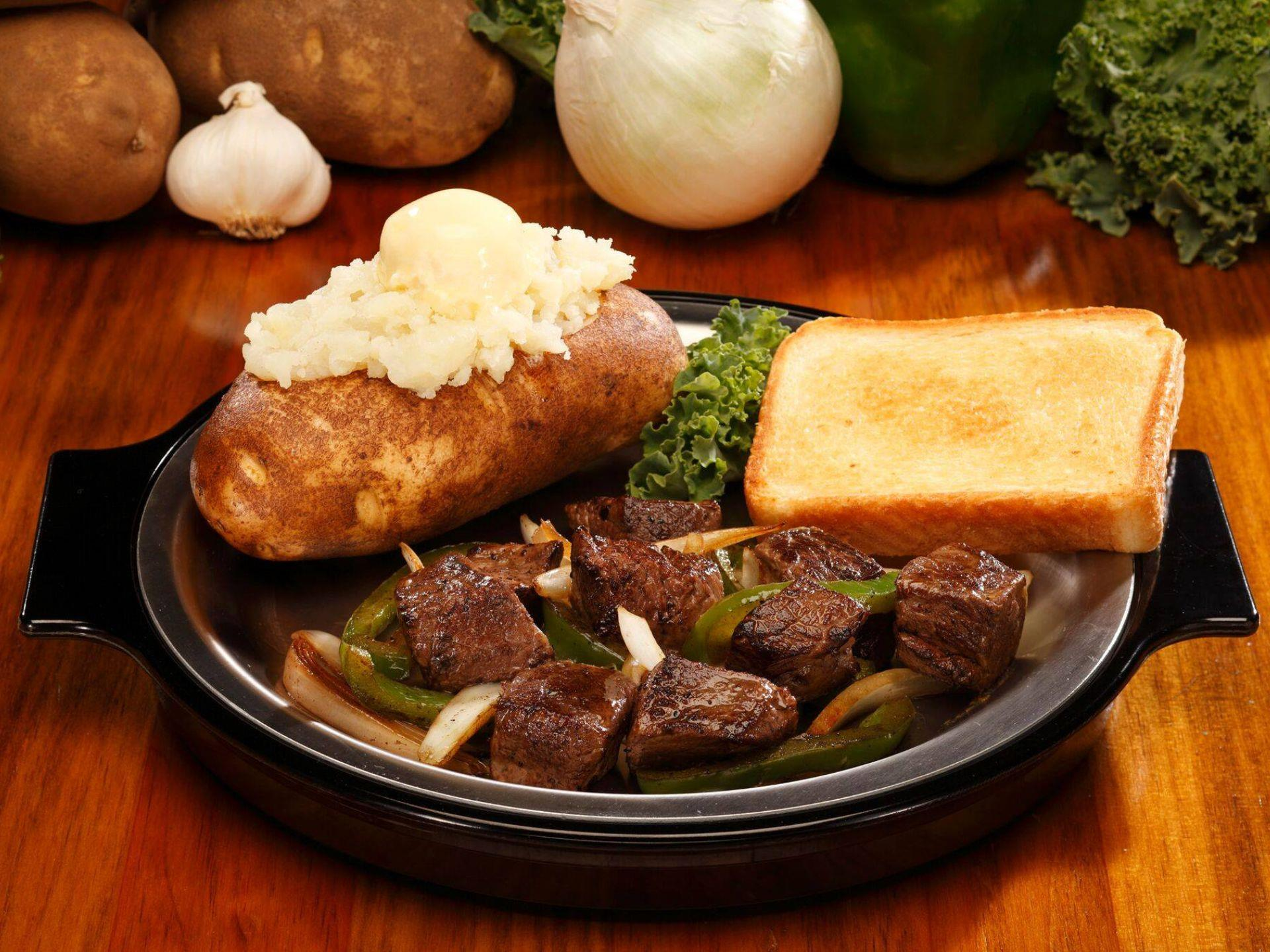 Steak skewers with baked potato and Texas toast