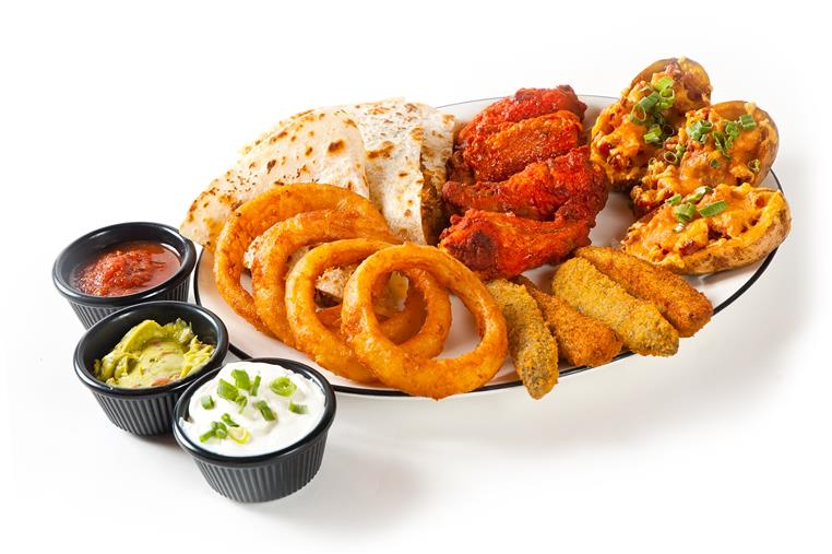 Appetizer tray with fries, chicken fingers, cole slaw and tater tots