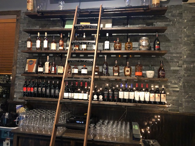 Bar area liquor shelves with ladder