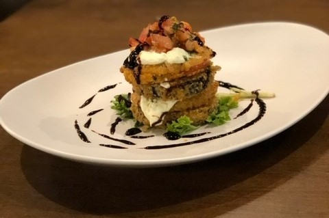 Eggplant Stacks layers of fried beefsteak tomato, eggplant, fresh mozzarella & tomato brushcetta