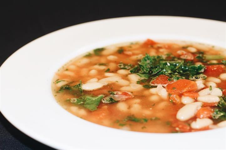 Classic white bean and kale soup made with the freshest of kale, cannellini beans, tomatoes, and sweet Italian sausage