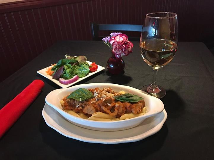 Grilled Chicken and Shrimp in our delicate rosemary cream sauce with fresh spinach, portabella mushrooms, and fresh mozzarella over penne pasta, served with house salad and a glass of white wine