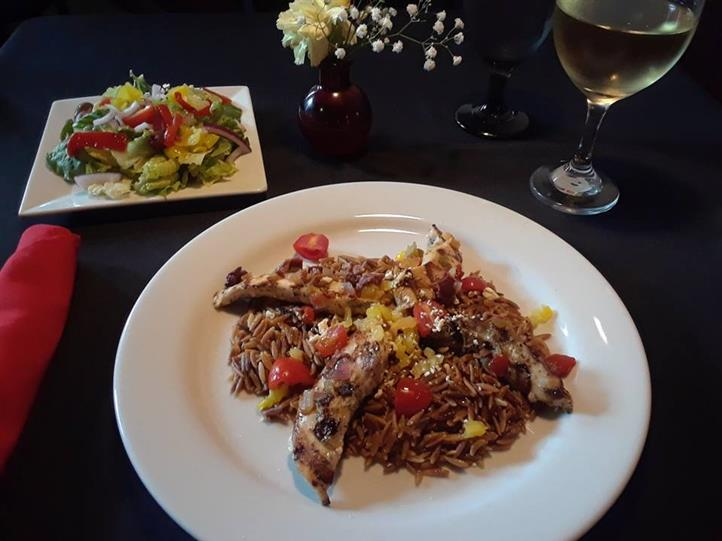 Lightly pan fried or grilled chicken breast in a lemon butter white wine sauce with capers served over linguine pasta, with a glass of white wine, served with side salad and a glass of white wine