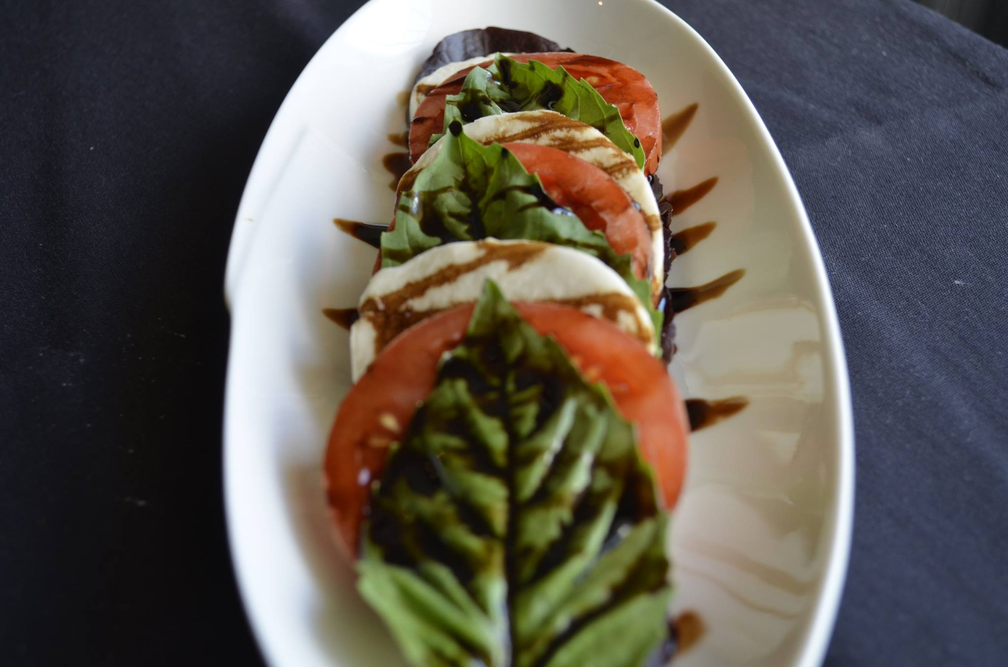 Tomato, basil and mozzarella salad on a plate