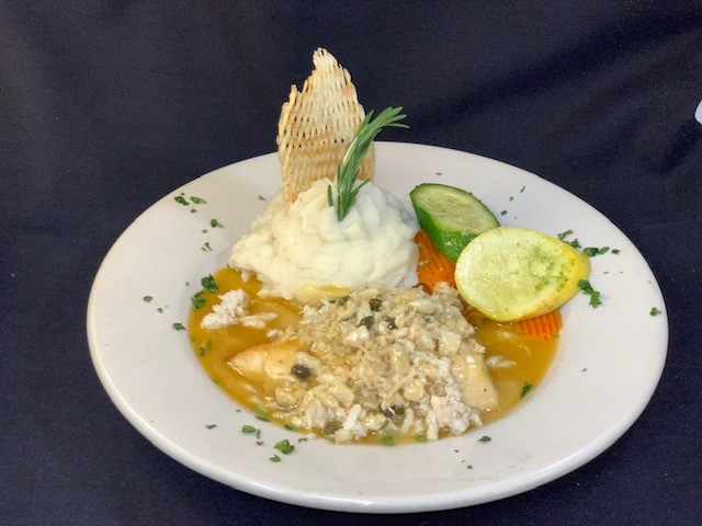 Grouper Island Style topped with blue crab