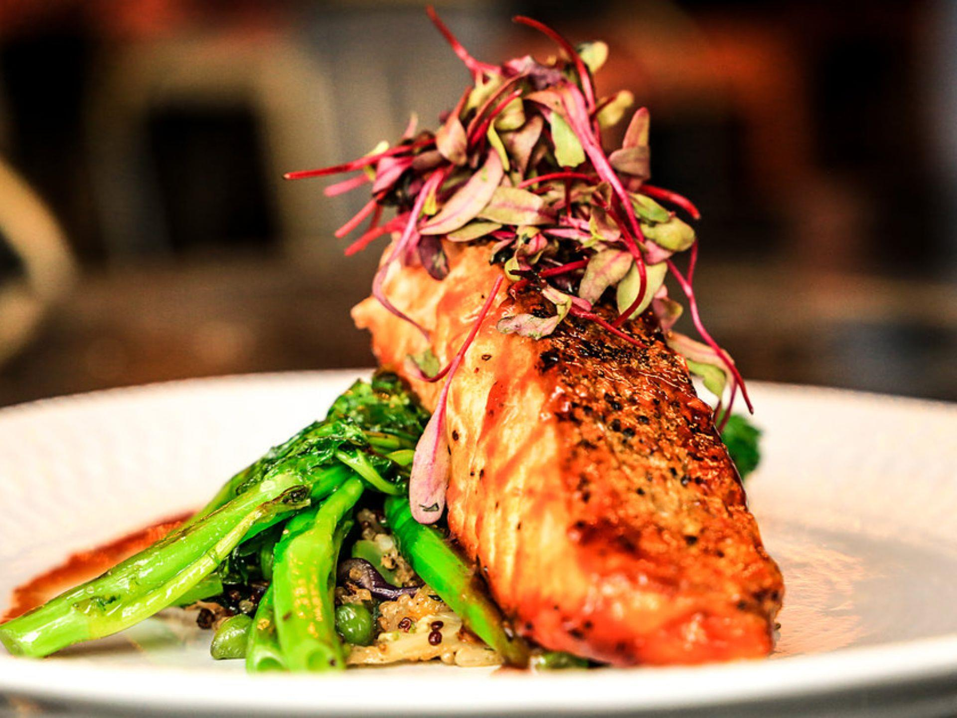 Salmon entree over broccolini