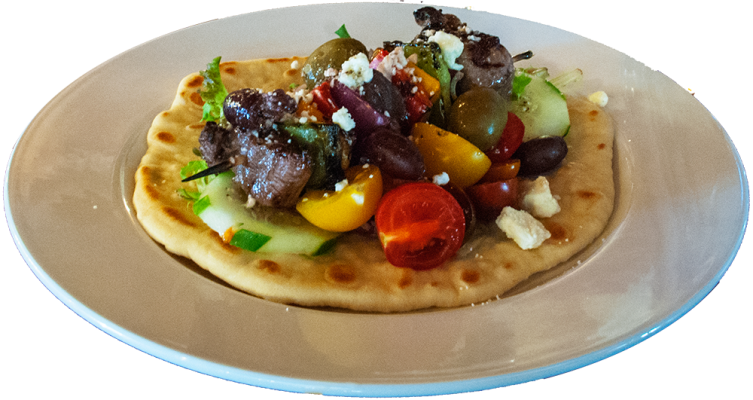 Steak flatbread over cucumbers, feta and tomatoes