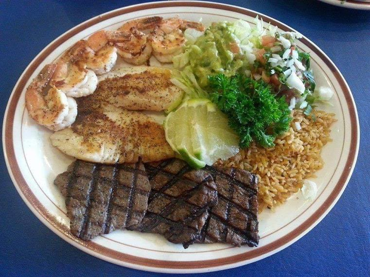 Jalisco Plate Five shrimp, beef chunks, onions and mushrooms sautéed in butter with garlic and special red sauce. Served with rice, guacamole salad and tortillas.
