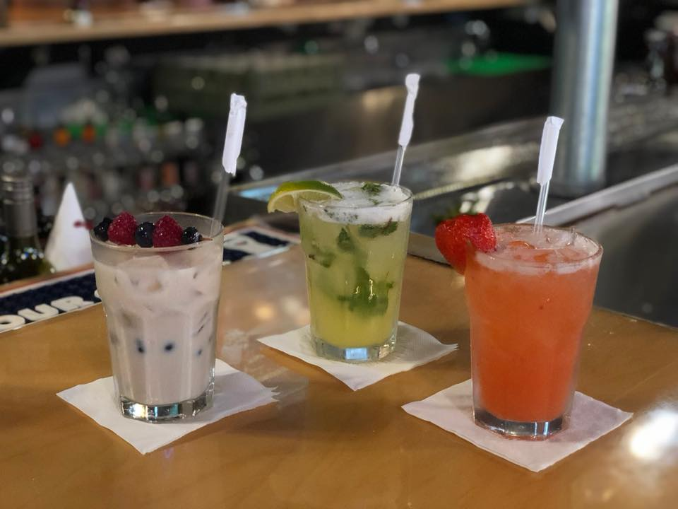 3 mixed cocktails on the bar