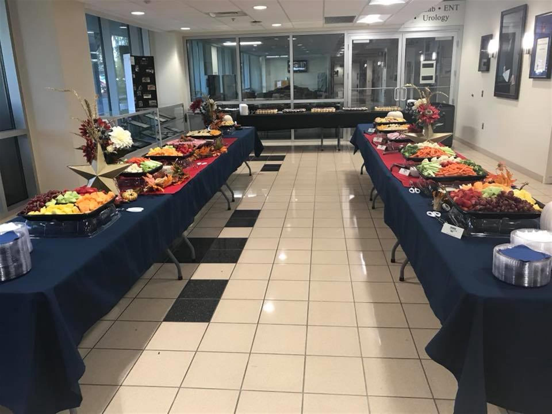 buffet tables setup for a catering event with platters of food