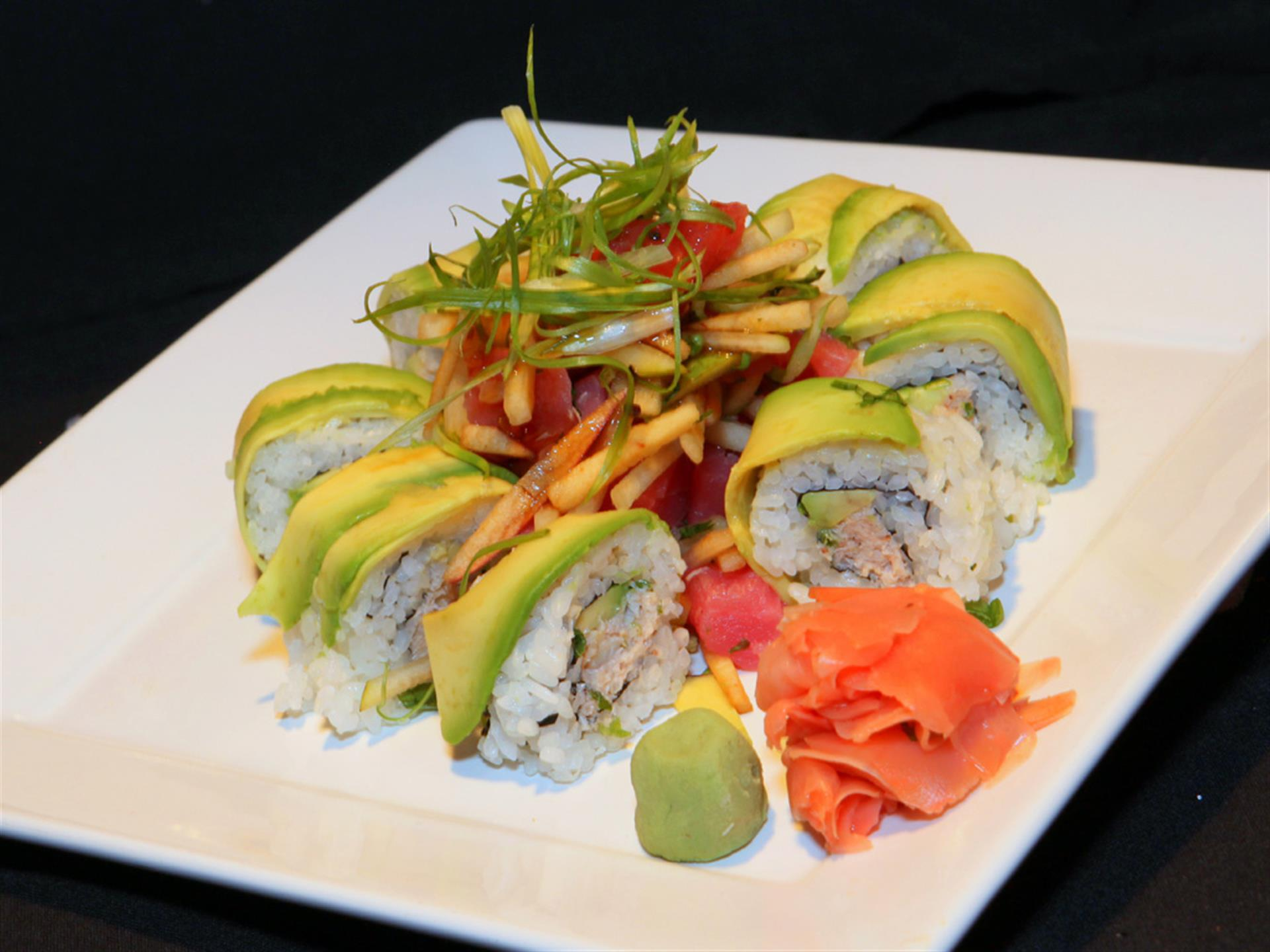 sushi roll topped with avocado in a circle