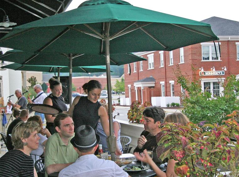 Waitress serving family on outdoor patio