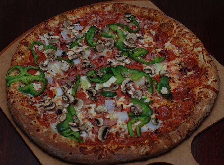 Pizza with peppers and mushrooms
