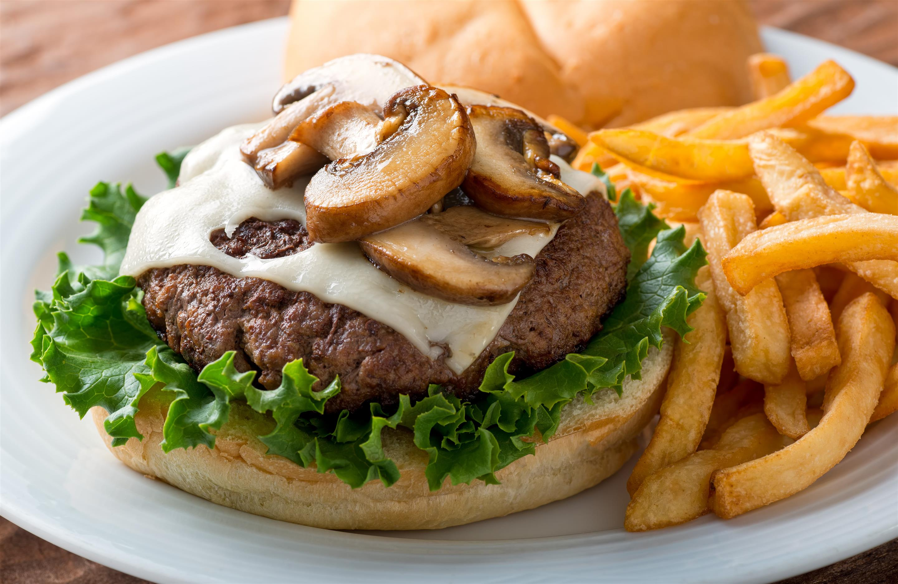 Burger topped with Mushroom and Cheese