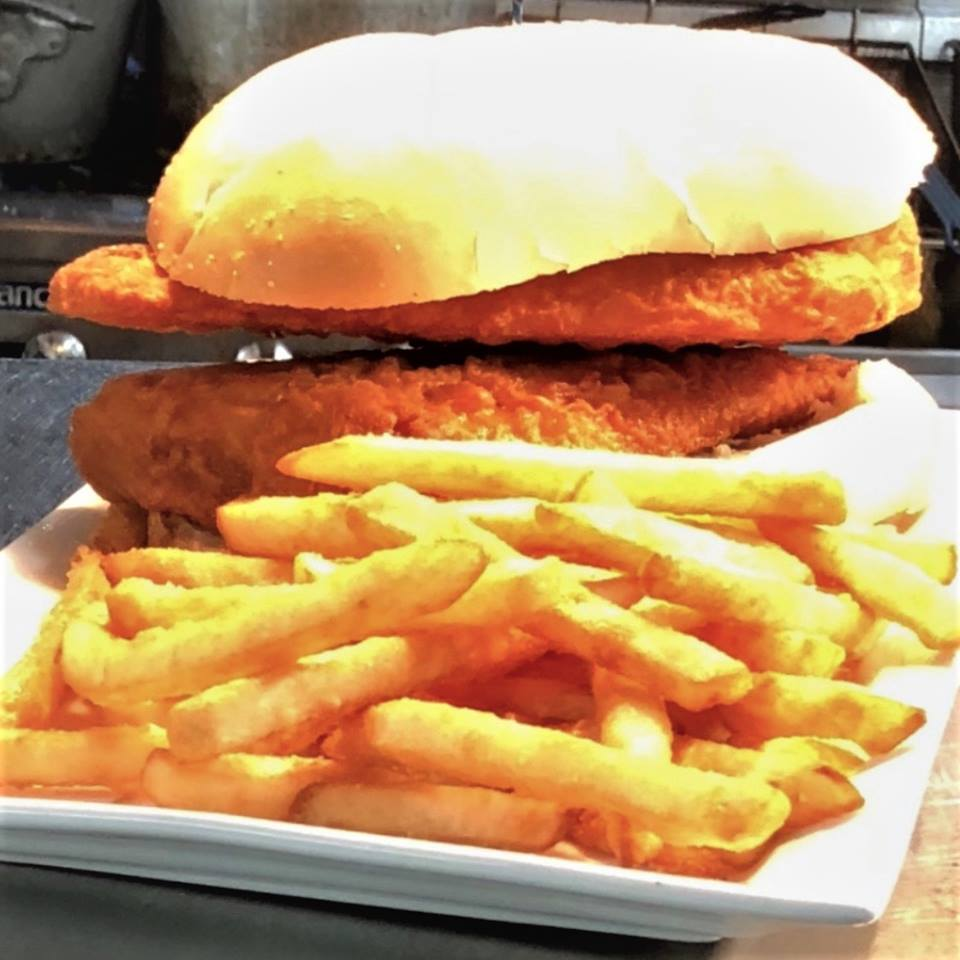 a fried chicken sandwich with a side of french fries