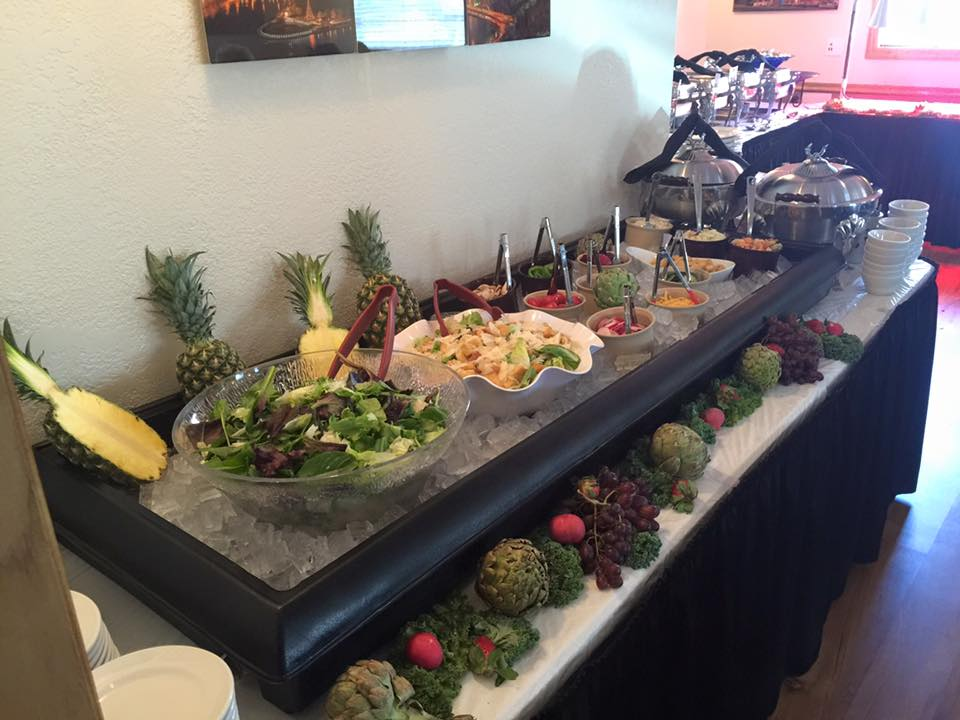 a buffet area showing different salads