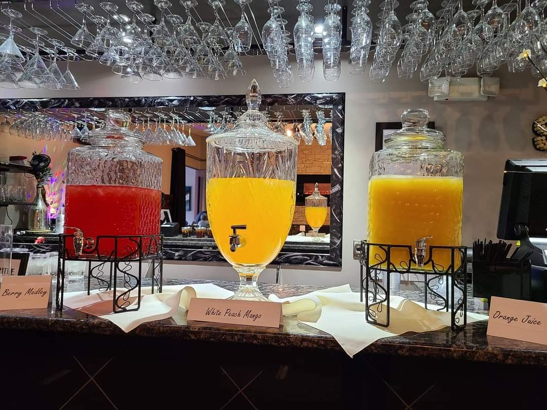 three drinks on bar in the sunset room