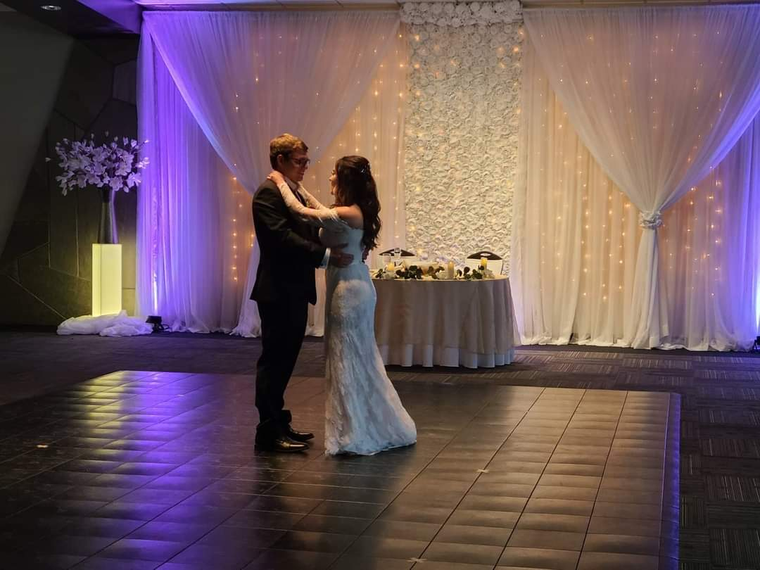 Bride and Groom dancing in Sunset Room