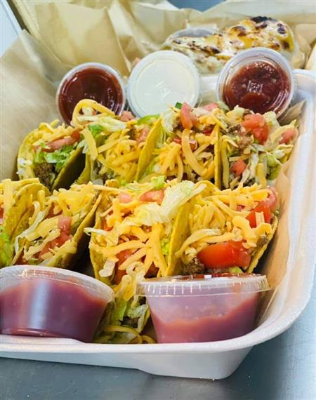 tacos in a takeout container