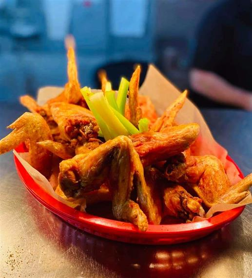 naked wings and celery in a basket