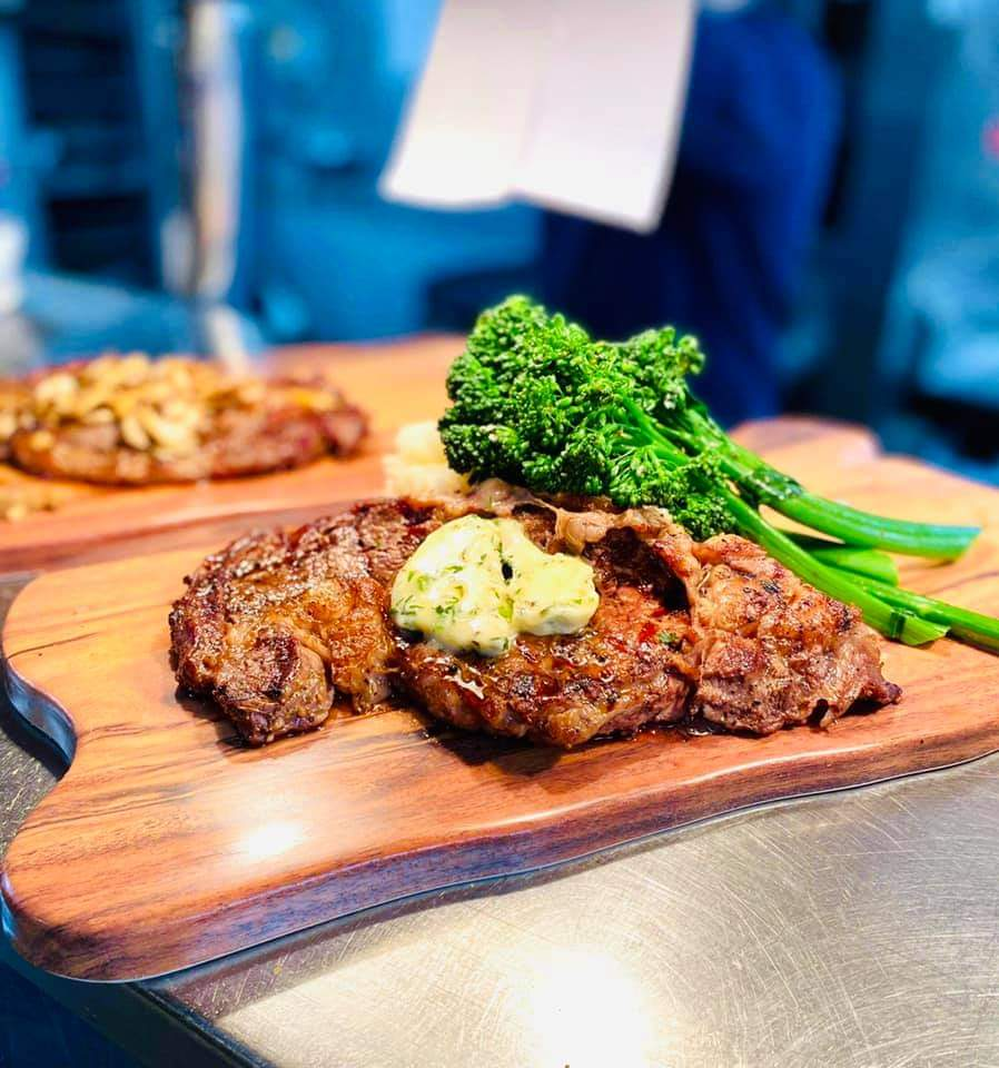 Ribeye with Melted Butter on Wooden Tray