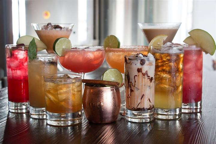 a variety of alcoholic drinks on the bar