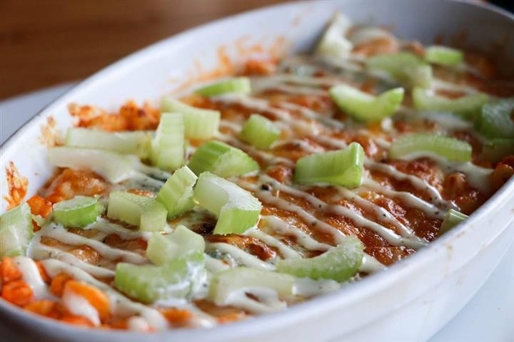 buffalo dip with ranch and celery on top