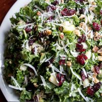 salad with cheese, nuts and raisins mixed in