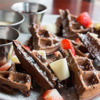 Chocolate waffle with white chocolate and fresh fruit
