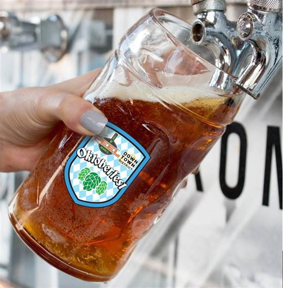 Down Town Oktoberfest Beer mug being filled with beer from tap