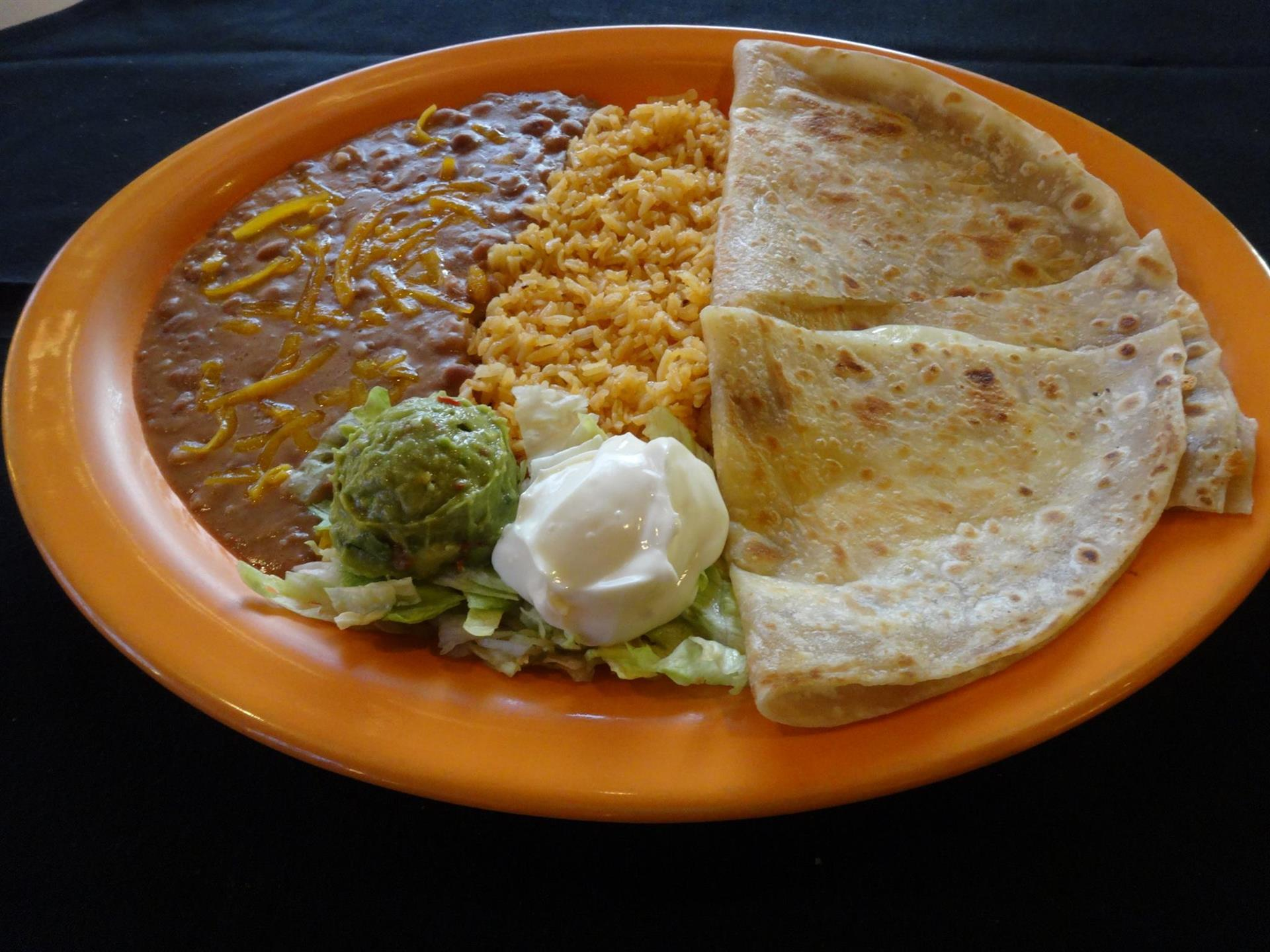 Cheese quesadilla with rice, beans, guacamole and sour cream