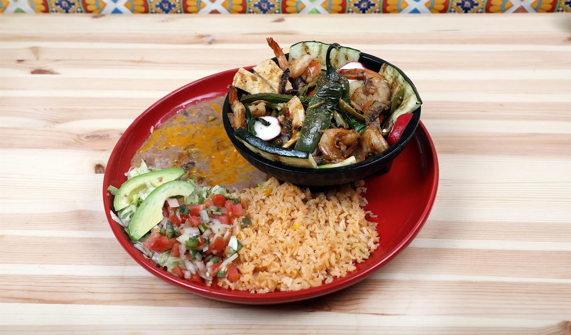 Mocajete Grill with a side of rice and beans